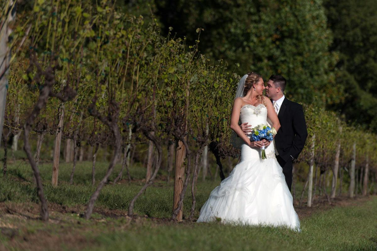 Vineyard wedding Bride in wedding dress with Groom in tuxedo
